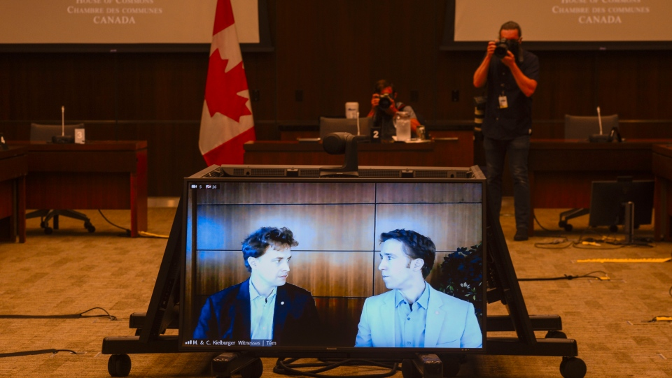 Marc Kielburger, screen left, and Craig Kielburger, screen right, appear as witnesses via videoconference during a House of Commons finance committee in the Wellington Building in Ottawa on Tuesday, July 28, 2020. WE Charity is closing its Canadian operations. The Toronto-based youth organization dropped the bombshell news to its staff this afternoon, with co-founders Craig and Marc Kielburger blaming COVID-19 and the controversy surrounding plans to have it run a federal student-volunteer program. THE CANADIAN PRESS/Sean Kilpatrick