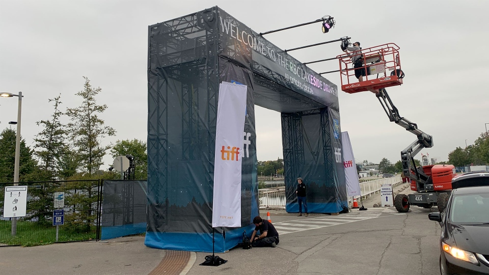 A crew sets up the entrance to the RBC Lakeside Drive-in for the Toronto International Film Festival at Ontario Place Wednesday September 10, 2020. (Joshua Freeman /CP24)