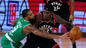 Toronto Raptors forward Pascal Siakam (43) drives on Boston Celtics guard Kemba Walker (8) during the second half of an NBA conference semifinal playoff basketball game Wednesday, Sept. 9, 2020, in Lake Buena Vista, Fla. (AP Photo/Mark J. Terrill)