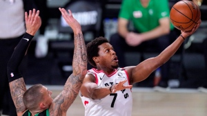 Toronto Raptors' Kyle Lowry, right, goes up for a shot against Boston Celtics' Daniel Theis during the first half of an NBA conference semifinal playoff basketball game Friday, Sept. 11, 2020, in Lake Buena Vista, Fla. (AP Photo/Mark J. Terrill)