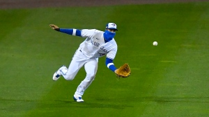 Toronto Blue Jays left fielder Lourdes Gurriel Jr. tries to catch a single hit by New York Mets' Michael Conforto during the fourth inning of a baseball game in Buffalo, N.Y., Friday, Sept. 11, 2020. Wilson Ramos scored from third. (AP Photo/Adrian Kraus)
