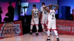 Toronto Raptors' Fred VanVleet (23), Norman Powell (24) and Serge Ibaka (9) head to the locker room after losing to the Boston Celtics during an NBA conference semifinal playoff basketball game Friday, Sept. 11, 2020, in Lake Buena Vista, Fla. The Celtics won 92-87. (AP Photo/Mark J. Terrill)