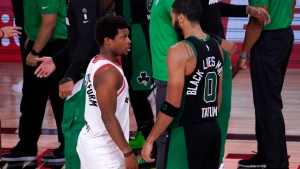 Toronto Raptors' Kyle Lowry, left, talks with Boston Celtics' Jayson Tatum after an NBA conference semifinal playoff basketball game Friday, Sept. 11, 2020, in Lake Buena Vista, Fla. The Celtics won 92-87. (AP Photo/Mark J. Terrill)