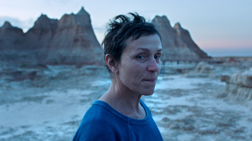 """This image released by Searchlight Pictures shows Frances McDormand in a scene from the film """"Nomadland"""" by Chloe Zhao. (Searchlight Pictures via AP)"""