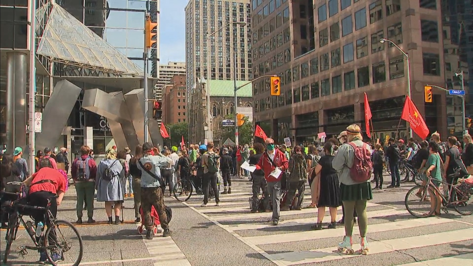 Hundreds protest the arrests of Six Nations land defenders outside the Ontario Ministry of Indigenous Affairs in downtown Toronto.