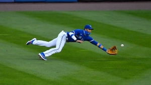 Toronto Blue Jays left fielder Lourdes Gurriel Jr. makes a diving catch for an out on a line drive by New York Mets' J.D. Davis during the third inning of a baseball game in Buffalo, N.Y., Saturday, Sept. 12, 2020. (AP Photo/Adrian Kraus)