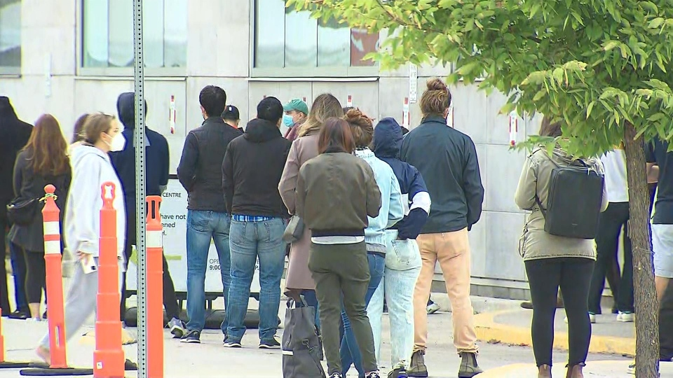 A large line is shown outside a COVID-19 testing centre at Women's College Hospital on Tuesday morning.