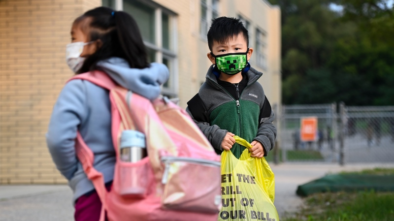 Kindergarten children line up using physical distancing before entering class at Portage Trail Community School which is part of the Toronto District School Board (TDSB) during the COVID-19 pandemic in Toronto on Tuesday, September 15, 2020. THE CANADIAN PRESS/Nathan Denette