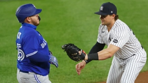 New York Yankees first baseman Luke Voit tags out Toronto Blue Jays' Alejandro Kirk during the first inning of a baseball game on Tuesday, Sept. 15, 2020, in New York. (AP Photo/Adam Hunger)
