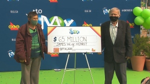 James Wickman (right) and his wife Eerikka (left) of Hearst drove to Toronto with family to collect a $65 million prize cheque.