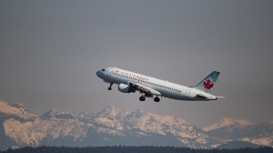 An Air Canada flight departing for Kelowna takes off at Vancouver International Airport, in Richmond, B.C., on Friday, March 20, 2020. THE CANADIAN PRESS/Darryl Dyck