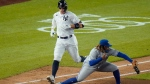Toronto Blue Jays third baseman Vladimir Guerrero Jr. fields the throw as New York Yankees Aaron Judge, left, is thrown out at first base during the sixth inning of a baseball game Wednesday, Sept. 16, 2020, in New York. (AP Photo/Frank Franklin II)