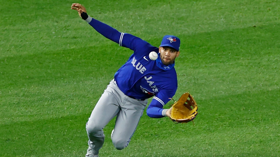 Toronto Blue Jays left fielder Lourdes Gurriel Jr. makes a catch on a fly out New York Yankees' Tyler Wade during the sixth inning of a baseball game on Tuesday, Sept. 15, 2020, in New York. (AP Photo/Adam Hunger)