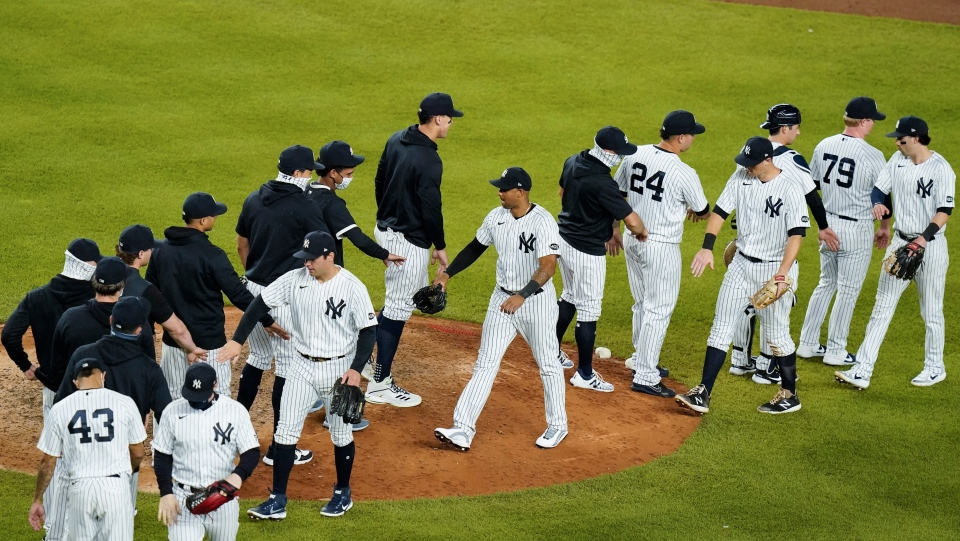 The New York Yankees celebrate after a baseball game against the Toronto Blue Jays Wednesday, Sept. 16, 2020, in New York. The Yankees won 13-2. (AP Photo/Frank Franklin II)