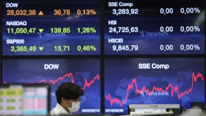 A currency trader watches monitors at the foreign exchange dealing room of the KEB Hana Bank headquarters in Seoul, South Korea, Thursday, Sept. 17, 2020. Asian stock markets declined Thursday after the U.S. Federal Reserve indicated its benchmark interest rate will stay close to zero at least through 2023 but announced no additional stimulus plans. (AP Photo/Ahn Young-joon)