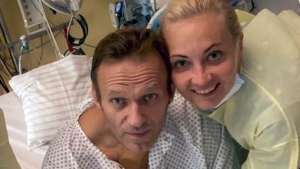 "This handout photo published by Russian opposition leader Alexei Navalny on his instagram account, shows himself and his wife Yulia, posing for a photo in a hospital in Berlin, Germany. Russian opposition leader Alexei Navalny has posted the picture Tuesday Sept. 15, 2020, with the caption ""Hi, this is Navalny. I have been missing you. I still can't do much, but yesterday I managed to breathe on my own for the entire day."" (Navalny instagram via AP)"