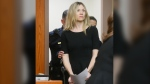"FILE - In this Feb. 14, 2013, file photo, Amy Locane enters the courtroom to be sentenced in Somerville, N.J. The former ""Melrose Place"" actress who has already served a prison sentence for a fatal 2010 drunken driving crash in New Jersey is headed back behind bars. A state judge on Thursday, Sept. 17, 2020, agreed with prosecutors that Locane's previous sentences were too lenient and gave the actress an eight-year sentence. (Patti Sapone/NJ Advance Media via AP, Pool, File"