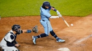 Toronto Blue Jays' Bo Bichette hits a two-run single during the ninth inning of a baseball game against the New York Yankees Thursday, Sept. 17, 2020, in New York. The Yankees won 10-7. (AP Photo/Frank Franklin II)