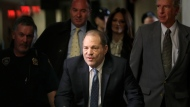 FILE - In this Monday, Feb. 24, 2020 file photo, Harvey Weinstein arrives at a Manhattan courthouse for jury deliberations in his rape trial, in New York. Britain has stripped disgraced movie mogul Harvey Weinstein of an honor recognizing his contribution to the UK film industry. The 68-year-old Weinstein was given the honor in 2004 and the decision to take it away was announced Friday Sept. 18, 2020. (AP Photo/Seth Wenig, File)