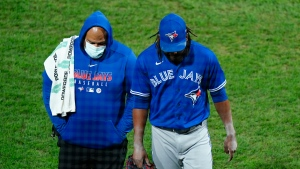 Toronto Blue Jays pitcher Rafael Dolis, right, walks off the field during the sixth inning of the second baseball game in a doubleheader against the Philadelphia Phillies, Friday, Sept. 18, 2020, in Philadelphia. (AP Photo/Matt Slocum)