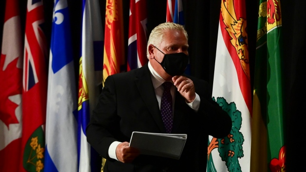 Ontario Premier Doug Ford leaves a press conference in Ottawa on Friday, Sept. 18, 2020. THE CANADIAN PRESS/Sean Kilpatrick