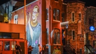 People gather under a mural of Supreme Court Justice Ruth Bader Ginsburg in the U Street neighborhood in Washington, Friday, Sept. 18, 2020, after the announcement that Ginsburg died of metastatic pancreatic cancer at age 87. (AP Photo/Pablo Martinez Monsivais)