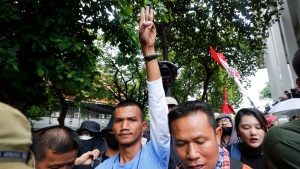 Pro-democracy protester Panupong Jadnok raises a three-finger symbol of resistance salute after entering Thammasat University during a protest in Bangkok, Thailand, Saturday, Sept. 19, 2020. Protesters gathered Saturday in Bangkok for what was expected to be the biggest rally yet in an ongoing campaign calling for a new election and democratic reforms. (AP Photo/Sakchai Lalit)