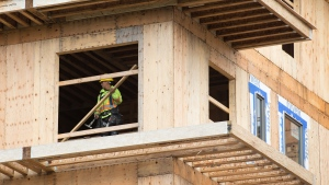 The Canada Mortgage and Housing Corp says the annual pace of construction on new homes picked up in July. A worker is seen working on a construction project at UBC in Vancouver, Tuesday, April 23, 2019. THE CANADIAN PRESS/Jonathan Hayward