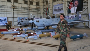 A soldier walks past two A-29 Super Tucanos on display during a hand over from Resolute Support (RS) to Afghan army at the military Airport in Kabul, Afghanistan, Thursday, Sept. 17, 2020. (AP Photo/Rahmat Gul)