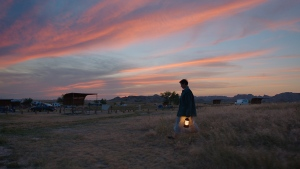 "This image released by Searchlight Pictures shows Frances McDormand in a scene from the film ""Nomadland"" by Chloe Zhao. McDormand stars as a woman living rootlessly across the American West after the Great Recession. (Searchlight Pictures via AP)"