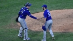 Toronto Blue Jays' Danny Jansen and Anthony Bass celebrate at the end of the ninth inning of a baseball game against the Philadelphia Phillies, Sunday, Sept. 20, 2020, in Philadelphia. (AP Photo/Michael Perez)