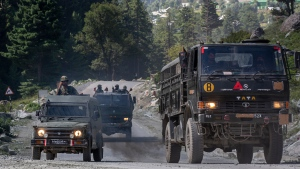 An Indian army convoy moves on the Srinagar- Ladakh highway at Gagangeer, northeast of Srinagar, Indian-controlled Kashmir, Wednesday, Sept. 9, 2020. China and India have been engaged in a tense standoff in the cold-desert Ladakh region since May, and their defense ministers met Friday in Moscow in the first high-level direct contact between the sides since the standoff began. (AP Photo/ Dar Yasin)