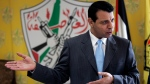 In this Jan. 3, 2011 file photo, Mohammed Dahlan speaks during an interview at his office in the West Bank city of Ramallah. (AP Photo/Majdi Mohammed, File)