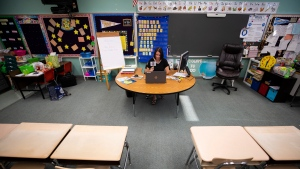 Valley View Elementary School first grade teacher Janelle Benke teaches a virtual lesson in her empty classroom on the first day of classes for Valley View in Blakely, Pa., Thursday, Aug. 27, 2020. (Christopher Dolan/The Times-Tribune via AP)
