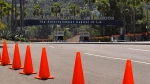 Cones block the entrance to a shuttered Universal Studios Hollywood, Wednesday, April 15, 2020, in Universal City, Calif. If Gov. Gavin Newsom's so-called roadmap to ease coronavirus restrictions hinted at a return to a normal Californians could appreciate - a summer trip in the car - it quickly became apparent they wouldn't be leaving home soon. The governor's sobering message foreshadows a summer without baseball games under the lights, large outdoor concerts, rides at amusement parks or trips to the beach. In short: a summer bummer. (AP Photo/Mark J. Terrill)