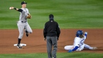 New York Yankees second baseman DJ LeMahieu, left, throws to first after forcing out Toronto Blue Jays' Vladimir Guerrero Jr. at second, completing a double play on Randal Grichuk during the seventh inning of a baseball game in Buffalo, N.Y., Tuesday, Sept. 22, 2020. (AP Photo/Adrian Kraus)
