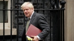 British Prime Minister Boris Johnson leaves 10 Downing Street in London, to attend the weekly Prime Minister's Questions at the Houses of Parliament, in London, Wednesday, Sept. 23, 2020. (AP Photo/Matt Dunham)