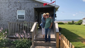 Renee Huart-Field and her husband, Mike Field, are pictured outside their home in Little Pond, P.E.I., in this undated handout photo. A couple of years ago, Huart-Field and her husband packed up their lives in Bracebridge, Ont., in pursuit of the retirees' dream. And for a while, they were living it. But now, Huart-Field says she's among the many snowbirds whose cross-border lifestyles have been derailed by the COVID-19 pandemic. THE CANADIAN PRESS/HO - Guy Fortin