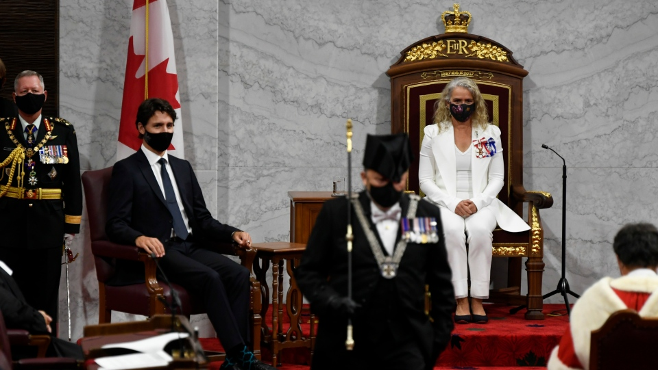 Gov.Gen. Julie Payette, middle, looks on with Chief of Defence Staff Jonathan Vance, left, and Prime Minister Justin Trudeau as the Usher of the Black Rod Greg Peters leaves to summon the House of Commons to come and listen to the throne speech in the Senate chamber in Ottawa on Wednesday, Sept. 23, 2020. THE CANADIAN PRESS/Adrian Wyld