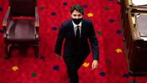 Prime Minister Justin Trudeau heads back to his seat before the delivery of the Speech from the Throne at the Senate of Canada Building in Ottawa, on Wednesday, Sept. 23, 2020. THE CANADIAN PRESS/Justin Tang