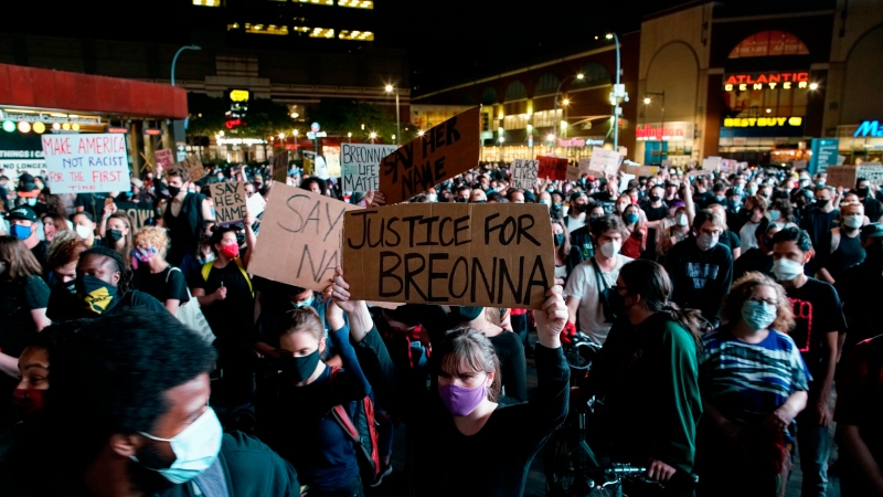 Protesters gather at Barclays Center, Wednesday, Sept. 23, 2020, in the Brooklyn borough of New York, following a Kentucky grand jury's decision not to indict any police officers for the killing of Breonna Taylor. (AP Photo/Eduardo Munoz Alvarez)