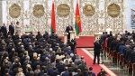 Belarusian President Alexander Lukashenko takes his oath of office during his inauguration ceremony at the Palace of the Independence in Minsk, Belarus, Wednesday, Sept. 23, 2020. Lukashenko of Belarus has assumed his sixth term of office in an inauguration ceremony that wasn't announced in advance. State news agency BelTA reports that the ceremony will take place with several hundred top government official present. (Sergei Sheleg/Pool Photo via AP)