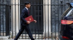 Britain's Chancellor of the Exchequer Rishi Sunak leaves No 11 Downing Street, heading for the House of Commons to unveil details of his Winter Economy Plan, in London, Thursday Sept. 24, 2020. (AP Photo/Frank Augstein)