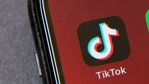 FILE - In this Friday, Aug. 7, 2020 file photo, the icons for the smartphone app TikTok on a smartphone screen in Beijing. (AP Photo/Mark Schiefelbein, File)