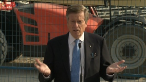 Mayor John Tory speaks with reporters at Studio City in the city's east end, where construction is underway on three new sound stages.