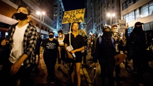 Protesters march through downtown Los Angeles, protesting officers not being charged with the killing of Breonna Taylor, Wednesday, Sept. 23, 2020. (Sarah Reingewirtz/The Orange County Register/SCNG via AP)