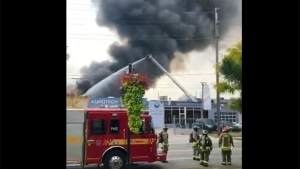 Crews battle a commercial fire on Kenhar Drive in North York Thursday September 24, 2020. (@EoanGorgees /Twitter)
