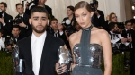 In this May 2, 2016 file photo, Zayn Malik, left, and Gigi Hadid arrive at The Metropolitan Museum of Art Costume Institute Benefit Gala in New York. (Photo by Evan Agostini/Invision/AP, File)