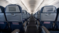 Empty seats are seen during a flight from Vancouver to Calgary, Tuesday, June 9, 2020. Airlines in Canada and around the world are suffering financially due to the lack of travel and travel bans due to COVID-19. THE CANADIAN PRESS/Jonathan Hayward