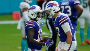 Buffalo Bills quarterback Josh Allen (17) congratulates wide receiver John Brown (15) after Brown scored a touchdown, during the second half of an NFL football game against the Miami Dolphins, Sunday, Sept. 20, 2020, in Miami Gardens, Fla. The Bills defeated the Dolphins 31-28. (AP Photo/Lynne Sladky)